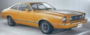 """1. What was your first car? My first car was a 1978 Ford Mustang. It was safety orange and a hatchback. Definitely not the """"cool"""" Mustang, but I could find it in any parking lot!"""