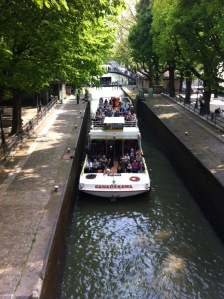 Just past the train station is the Canal Saint Martin, with beautiful little cross bridges, restaurants, and shops.