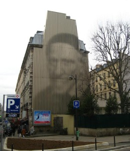If you went up the street toward the train station, Gare du Nord—and if you remembered to look up— you might see the incredible building-sized sculpture of St. Vincent de Paul. Placed in 1987 by the artist Jean-Pierre Yvaral, it uses slightly twisted blades of metal to create the shading.