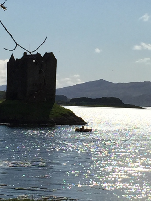 Castle Stalker, inspiration for Highland Magic. TEASER - for THIS HIGHLAND MAGIC Dr Henriette Bruar travels to north to catalogue the library in an ancient castle set in the middle of a remote Highland loch. The laird, Sir Malcolm MacKenzie, of that Ilk, is pressed for cash and selling off the estate's assets, including the library. This doesn't please his son, Keir, who fears there will be nothing of the estate left to inherit. To all outward appearances, Henriette seems like just any run of the mill academic, unremarkable even. However, she sees herself as a cross between Indiana Jones and the Relic Hunter, and dreams of one day finding a precious manuscript, a hidden treasure or the key to unlocking family secrets. By the end of the novel, Henri learns that treasure comes in many guises and, sometimes, family secrets are best left undisturbed.