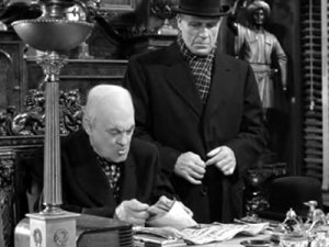 Mr. Potter (Lionel Barrymore) with the bank deposit. That he does not give back. [Image Credit: It's a Wonderful Life, 1946 Directed by Frank Capra]