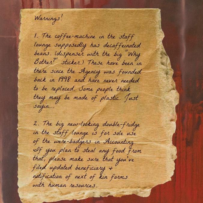 Handwritten note taped to cabinet in staff break room.