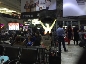 The Mumbai Domestic Terminal, including a lit up guy holding a giant tire. Of course.