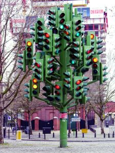 British traffic humor: I encountered this in the middle of a roundabout. I cried. [Image credit: Traffic-light-tree by Pierre Vivant. ]