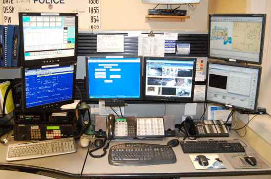 Dispatch Desk [image credit: Massachusetts Communications Supervisors Assn.] http://ma911.org/