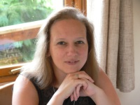 Author Suzanne Rogerson lives in Middlesex, England with her hugely encouraging husband and two children. She wrote her first novel at the age of twelve. She discovered the fantasy genre in her late teens and has never looked back. Giving up work to raise a family gave her the impetus to take her attempts at novel writing beyond the first draft, and she is lucky enough to have a husband who supports her dream - even if he does occasionally hint that she might think about getting a proper job one day. Suzanne loves gardening and has a Hebe (shrub) fetish. She enjoys cooking with ingredients from the garden, and regularly feeds unsuspecting guests vegetable-based cakes. She collects books, loves going for walks and picnics with the children and sharing with them her love of nature and photography. Suzanne is interested in history and enjoys wandering around castles. But most of all she likes to escape with a great film, or soak in a hot bubble bath with an ice cream and a book.